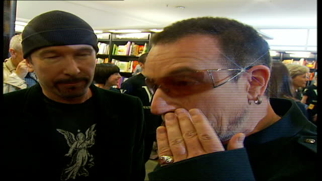 interviews and photocall the edge and bono interview with tamzin sylvester sot on bono being saviour of the world / solidarity within u2 /... - david 'the edge' howell evans stock videos and b-roll footage