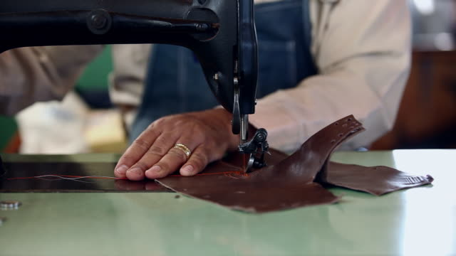 ms boot maker sewing boot shaft of cowboy boots - sewing machine stock videos & royalty-free footage