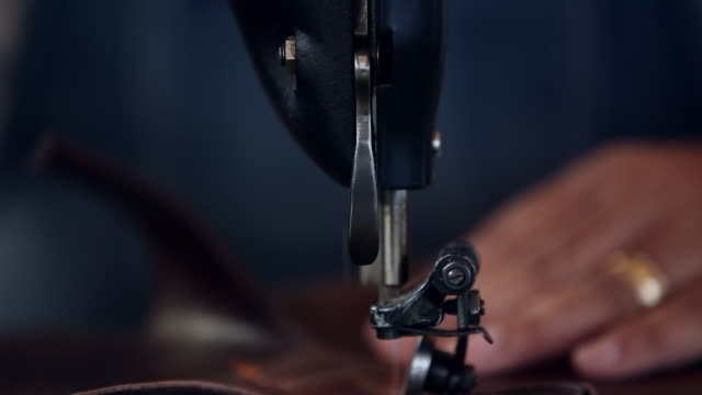 cu boot maker sewing boot shaft of cowboy boots - sewing machine stock videos & royalty-free footage