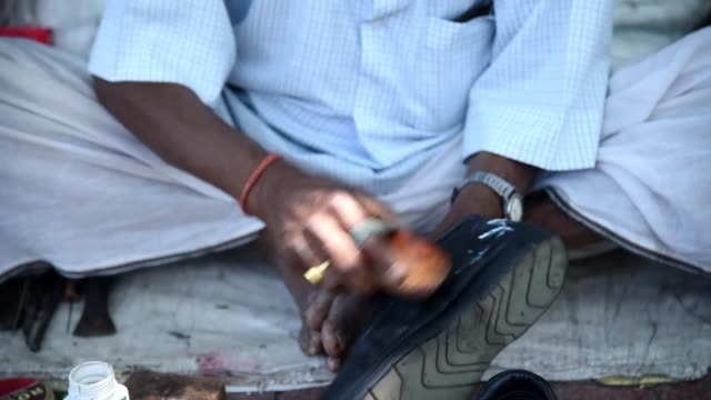 a boot polisher working in a street - kolkata stock videos & royalty-free footage