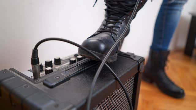 boot stepping on guitar amp - jeans stock videos & royalty-free footage