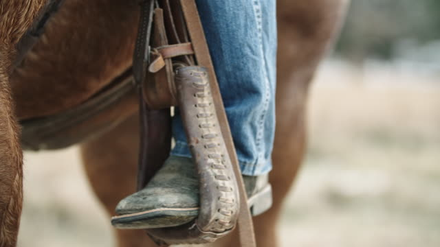 a boot steps out of a stirrup - rancher stock videos & royalty-free footage