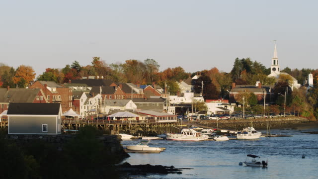 booth bay in maine with lobster boats and shore. - eastern usa stock videos and b-roll footage