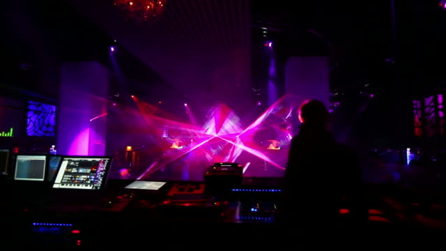 hd dj booth in front of disco dancers - techno music stock videos & royalty-free footage