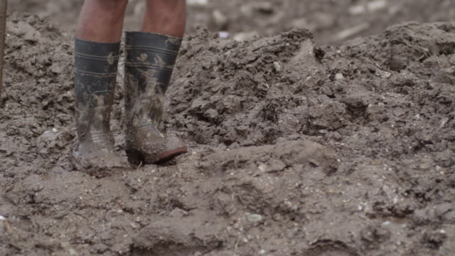 nepal - august 3, 2015: cu boots in mud - mud stock videos & royalty-free footage