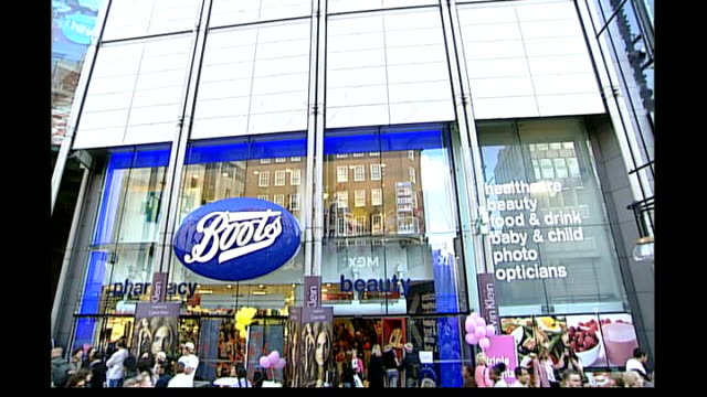 boots in takeover bid date large boots store and shoppers in large boots store sign for aspirin with boots logo in corner - aspirin stock videos & royalty-free footage