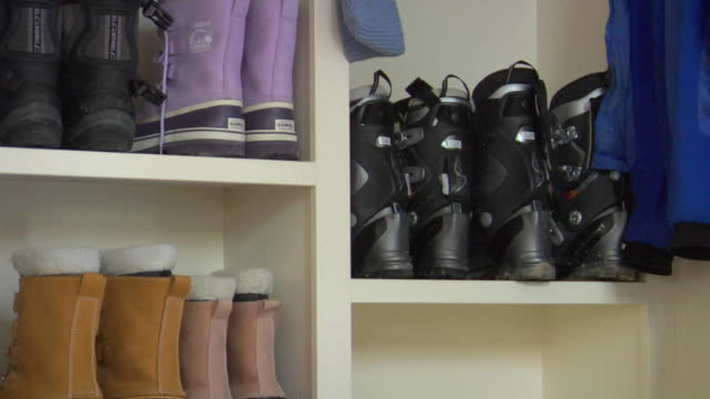 CU, Boots on shelves in cabin, Whitefish, Montana, USA