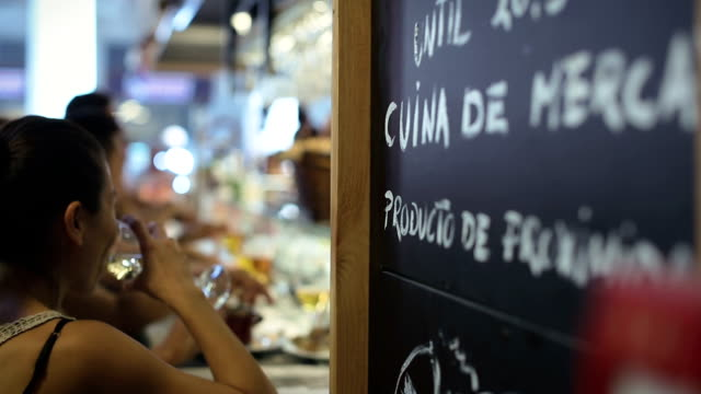 boqueria market restaurant in barcelona - spanish culture stock videos & royalty-free footage