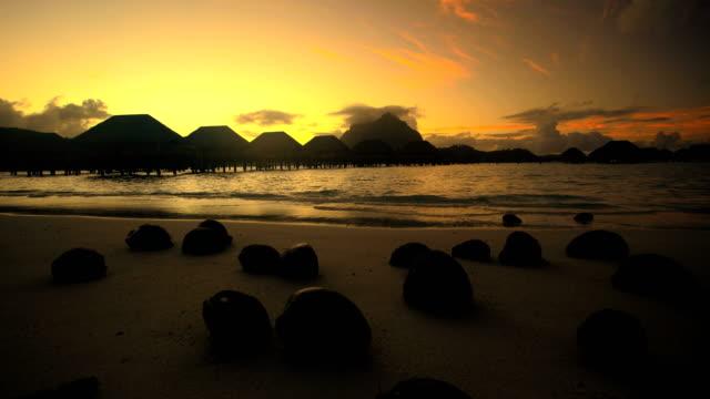 bora bora island beach at sunset overwater bungalows - polynesian ethnicity stock videos & royalty-free footage