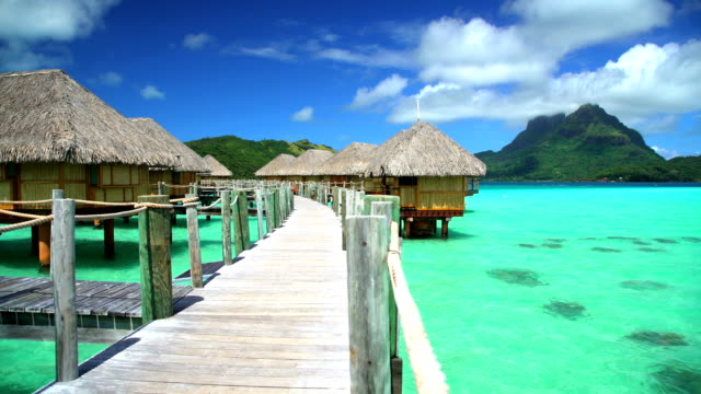 bora bora island walkway aquamarine lagoon luxury resort - polynesian ethnicity stock videos & royalty-free footage