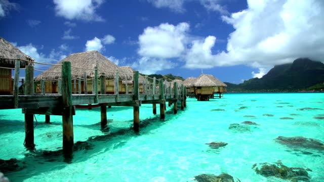 bora bora island walkway overwater bungalows aquamarine lagoon - polynesian ethnicity stock videos & royalty-free footage