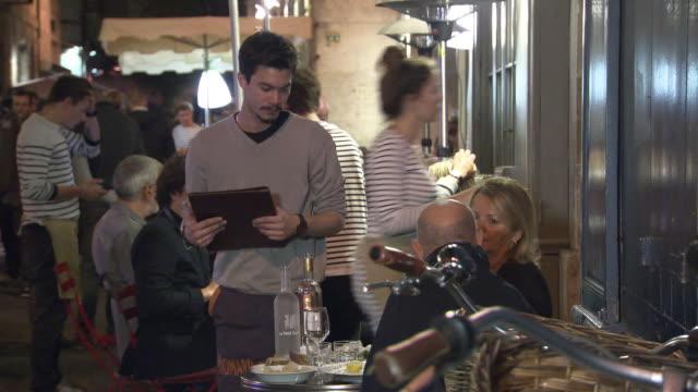 bordeaux's bustling restaurant scene - restaurant stock videos & royalty-free footage