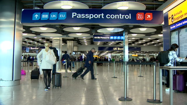 uk border agency passport control at heathrow airport terminal 5 - control stock videos & royalty-free footage