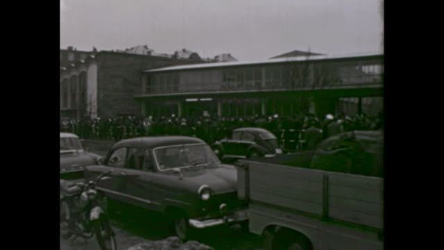 border at street guineastraße large crowd of people waiting to receive permits to travel to east berlin / sign at the door of the house that says... - east berlin stock videos and b-roll footage