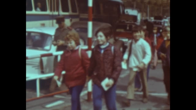 border crossing between gdr and czechoslovakia, typical eastern germany cars like trabant and wartburg passing, teacher with a school class passing... - überqueren stock-videos und b-roll-filmmaterial