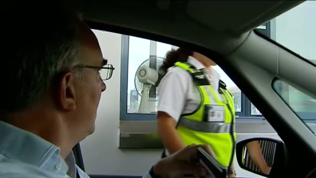 border crossing dispute continues int car shot through windscreen along road towards border crossing into gibraltar reporter chatting to border... - official car stock videos & royalty-free footage