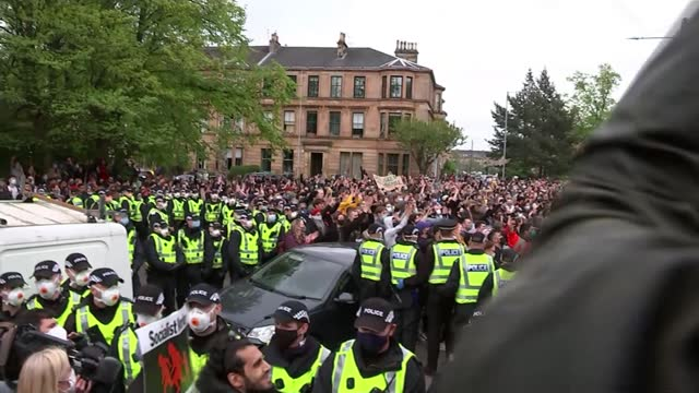 border force operation in glasgow sparks huge protest; scotland: glasgow: ext two indian men - sumit sehdev and lakhvir singh led along by police... - politics stock videos & royalty-free footage