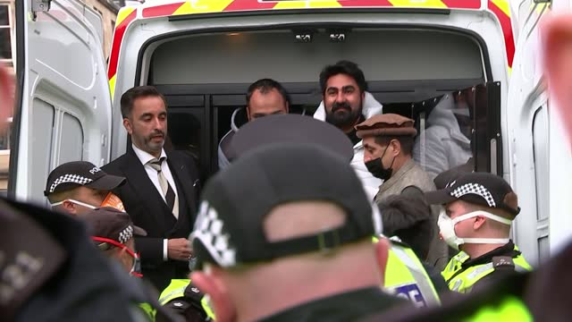 border force operation in glasgow sparks huge protest; scotland: glasgow: ext crowd cheer as police officers open uk border force van doors and two... - politics stock videos & royalty-free footage
