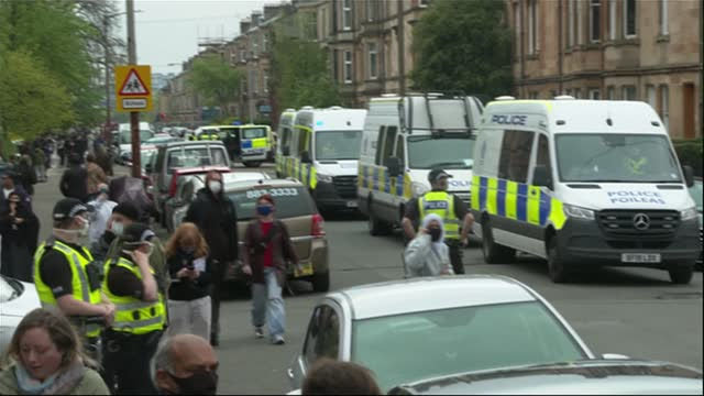 border force operation in glasgow sparks huge protest; scotland: glasgow: ext crowd of protesters surround border force 'immigration enforcement' van... - politics stock videos & royalty-free footage