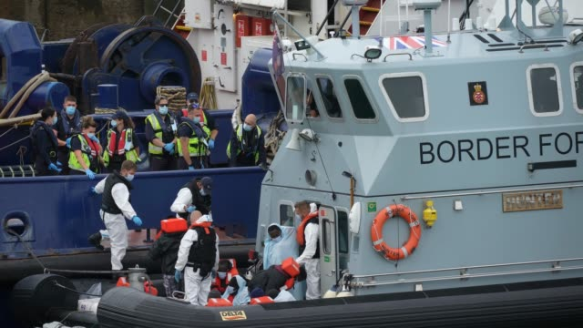 border force patrol cutter 'hunter' at dover port begin the process to disembark nine migrants rescued from a dinghy which had engine failure and... - sea channel stock videos & royalty-free footage