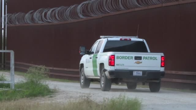 border officials in the us patrol a border fence in mcallen texas after donald trump's visit there to defend his wall project a source of intense... - vox populi stock videos & royalty-free footage