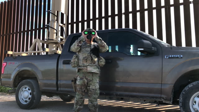 border patrol agent carlos ruiz for undocumented immigrants next to the u.s.-mexico border fence on september 10, 2019 in penitas, texas. border... - mcallen texas stock videos & royalty-free footage