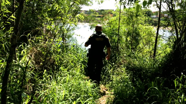 a us border patrol agent climbs up from the bank of the rio grande at the usmexico border on march 14 2017 in roma texas he and fellow agents had... - deportation stock videos and b-roll footage