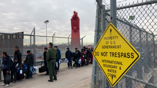 us border patrol agent speaks with central american immigrants at the usmexico border fence on february 01 2019 in el paso texas the migrants were... - united states border patrol stock videos & royalty-free footage