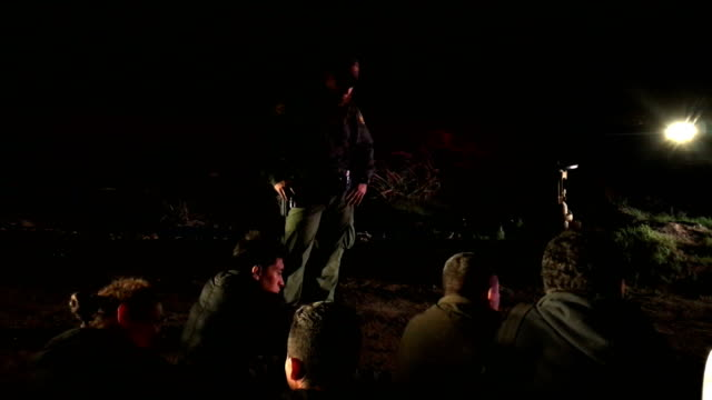 us border patrol agent watches over a group of detained undocumented immigrants on february 23 2018 in mcallen texas the agents captured the group of... - united states border patrol stock videos & royalty-free footage