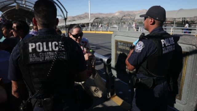 US Border Patrol agents check passports at the Paso Del Norte Port of Entry where the US and Mexico border meet as people walk across the bridge to...