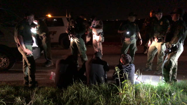 border patrol agents detain undocumented immigrants, including a 16-year-old minor, from mexico on september 10, 2019 in mission, texas. they had... - mcallen texas stock videos & royalty-free footage
