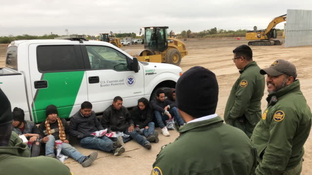 border patrol agents detain undocumented immigrants who they caught near the construction site of a privately-built border wall on december 11, 2019... - alien stock videos & royalty-free footage