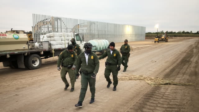 s border patrol agents detain undocumented immigrants who they caught near the construction site of a privatelybuilt border wall on december 11 2019... - united states border patrol stock videos & royalty-free footage