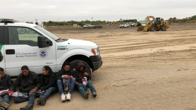 border patrol agents detain undocumented immigrants who they caught near the construction site of a privately-built border wall on december 11, 2019... - detainee stock videos & royalty-free footage