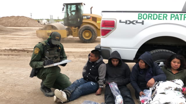 border patrol agents detain undocumented immigrants who they caught near the construction site of a privately-built border wall on december 11, 2019... - refugee stock videos & royalty-free footage