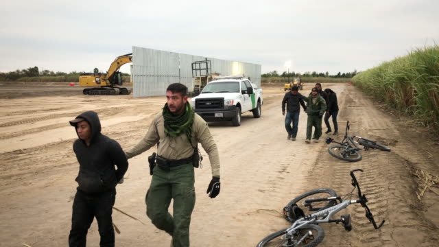 border patrol agents detain undocumented immigrants who they caught near the construction site of a privately-built border wall on december 11, 2019... - geographical border stock videos & royalty-free footage