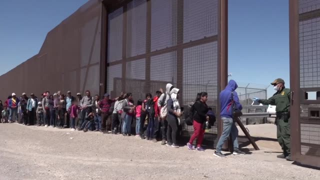 border patrol agents engage with migrants entering the united states along the southwest border during march 2019 in texas and arizona. - law stock videos & royalty-free footage