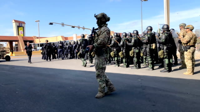 US Border Patrol agents in riot gear take part in a training exercise at the USMexico border on November 5 2018 in Hidalgo Texas Days before US Army...