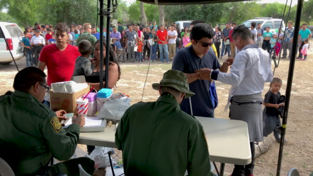border patrol agents interview immigrants, including a blind man from el salvador, after taking them into custody on july 02, 2019 in los ebanos,... - mcallen texas stock videos & royalty-free footage