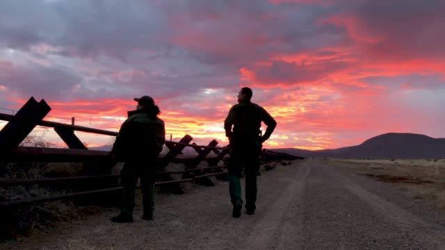 US Border Patrol agent's patrol the USMexico border fence on January 30 2019 in Antelope Wells New Mexico Since October dozens of large groups of...