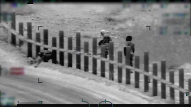 border patrol observe several men armed with rifles escort a mother and child to the international boundary west of lukeville, arizona. the armed men... - international border stock videos & royalty-free footage