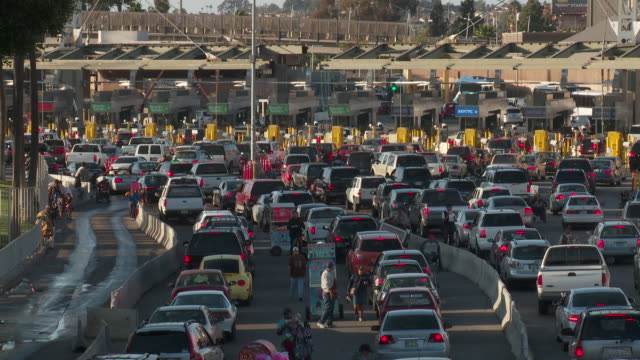 ws border traffic in tijuana crossing into us  - control stock videos & royalty-free footage