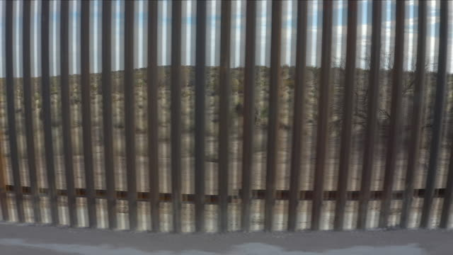 us border wall aerial view - international border barrier stock videos & royalty-free footage