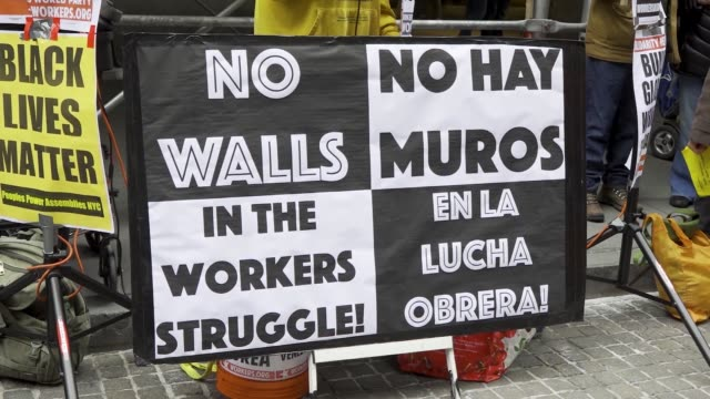 border wall banner. new york city - wall street, international workers day . footage by tomas abad/getty images). - international border stock videos & royalty-free footage