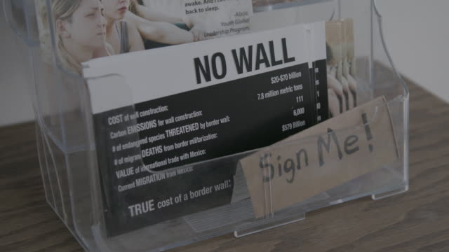 border wall true cost information card, close-up - pamphlet stock videos & royalty-free footage