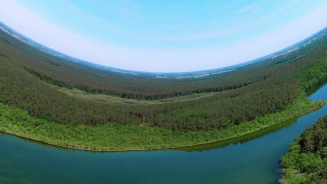 vídeos de stock, filmes e b-roll de mundos sem fronteiras. paisagem de dobra do lago e da floresta - distorcido