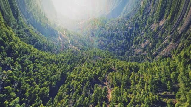 vídeos de stock e filmes b-roll de borderless worlds. bending mountain and forest landscape - distorcido