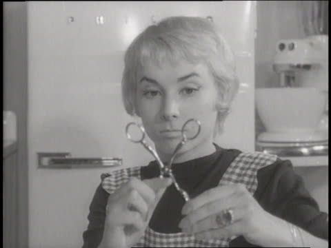 a bored housewife creates a face using a mop - stay at home mother stock videos & royalty-free footage