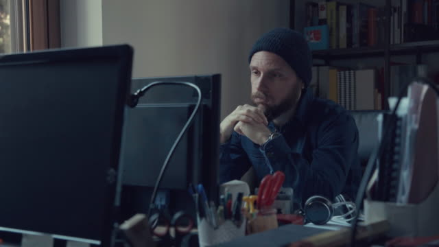 bored man at work in the coworking startup office - boredom stock videos and b-roll footage