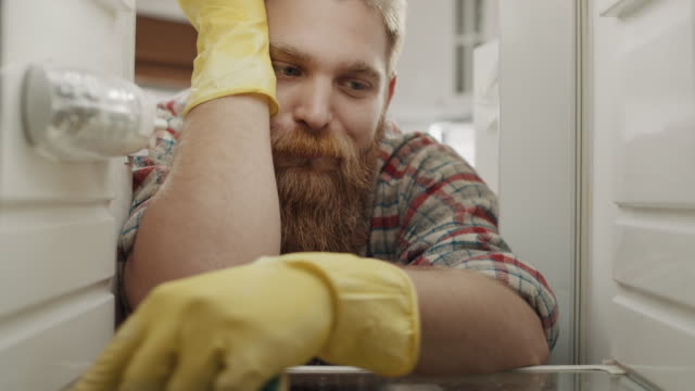 bored man cleaning - housework stock videos & royalty-free footage